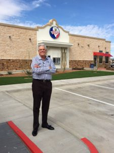 Bobby Cox standing in front of Texas Burger